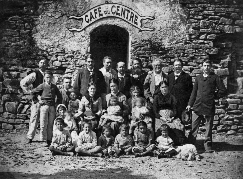 Gustave Courbet (at the middle top) and his friends in front of the Café du Centre. Municipal records.